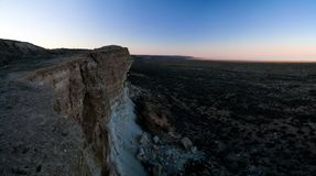 Panorama view to Aral sea from the rim of Plateau Ustyurt near Aktumsuk cape at sunset, Karakalpakstan, Uzbekistan. Panorama view to Aral sea from the rim of Stock Photography