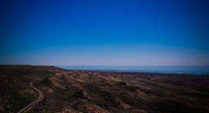 Panorama view to Aral sea from the rim of Plateau Ustyurt near Duana cape , Karakalpakstan, Uzbekistan Royalty Free Stock Image