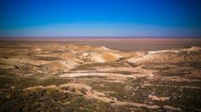 Panorama view to Aral sea from the rim of Plateau Ustyurt at sunset , Karakalpakstan, Uzbekistan. Panorama view to Aral sea from the rim of Plateau Ustyurt at Stock Photography