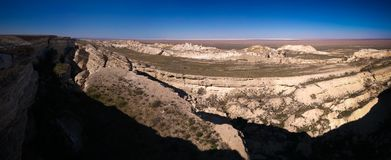 Panorama view to Aral sea from the rim of Plateau Ustyurt at sunset , Karakalpakstan, Uzbekistan. Panorama view to Aral sea from the rim of Plateau Ustyurt at Stock Images