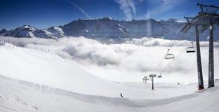 Panorama view to chair lift in Elm ski resort, Swiss Alps, Switz Stock Photo