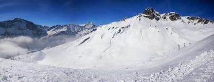 Panorama view to chair lift in Elm ski resort, Swiss Alps, Switz Stock Photos