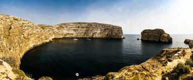 Panorama view to Dwejra bay and Fungus rock, Gozo, Malta. Panorama view to Dwejra bay and Mushroom aka Fungus rock, Gozo, Malta Royalty Free Stock Images