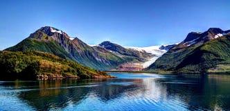 Panorama view to Nordfjorden and Svartisen glacier, Meloy, Norway. Panorama view to Nordfjorden and Svartisen glacier at Meloy, Norway stock photography