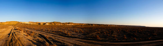Panorama view to Plateau Ustyurt from the edge of Aral sea near Aktumsuk cape at sunrise, Karakalpakstan, Uzbekistan. Panorama view to Plateau Ustyurt from the Royalty Free Stock Photos