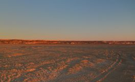 Panorama view to Plateau Ustyurt from the edge of Aral sea near Aktumsuk cape at sunset, Karakalpakstan, Uzbekistan. Panorama view to Plateau Ustyurt from the Royalty Free Stock Photography