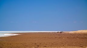 Panorama view to saline Barsa Kelmes lake and Ustyurt plateau in Karakalpakstan, Uzbekistan. Panorama view to saline Barsa Kelmes lake and Ustyurt plateau at Royalty Free Stock Photography