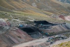 Panorama view to Tian Shan mountain and Coal Mine Kara-Keche, Naryn Province, Kyrgyzstan royalty free stock images
