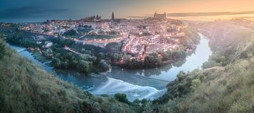Panorama view of Toledo and Tagus River, Spain. Panorama view of ancient city and Alcazar castle on a hill over the Tagus River, Castilla la Mancha, Toledo stock image