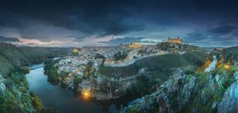Panorama view of Toledo and Tagus River, Spain. Panorama view of ancient city and Alcazar castle on a hill over the Tagus River, Castilla la Mancha, Toledo royalty free stock images