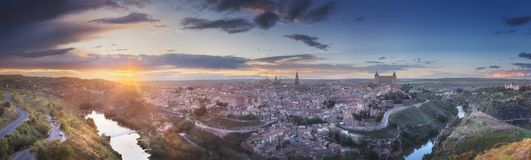 Panorama view of Toledo and Tagus River, Spain. Panorama view of ancient city and Alcazar castle on a hill over the Tagus River, Castilla la Mancha, Toledo stock photo