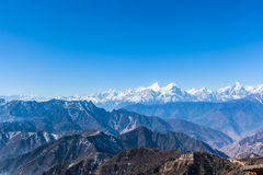 Panorama view on top of cattle back mountain. Panorama view of the mountain range including Minya Konka (7556m) from top of cattle back mountain in the morning royalty free stock photo