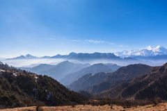 Panorama view on top of cattle back mountain. Panorama view of the mountain range including Minya Konka (7556m) from top of cattle back mountain in the morning stock images