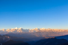 Panorama view on top of cattle back mountain. Panorama view of the mountain range including Minya Konka (7556m) from top of cattle back mountain in the morning stock photos