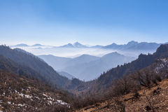 Panorama view on top of cattle back mountain. Panorama view of the mountain range with mist from top of cattle back mountain in the morning, Sichuan Province stock image