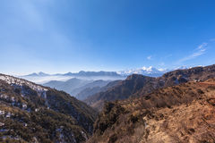 Panorama view on top of cattle back mountain. Panorama view of the mountain range with mist from top of cattle back mountain in the morning, Sichuan Province royalty free stock photos