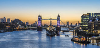 Panorama view of Tower Bridge and HMS Belfast  at sunrise in Lon Royalty Free Stock Image