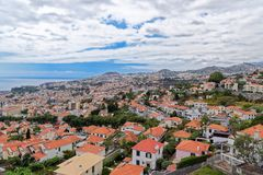 Panorama view at traditional houses against blue cloudy sky on Madeira island. Funchal city, Portugal stock photos