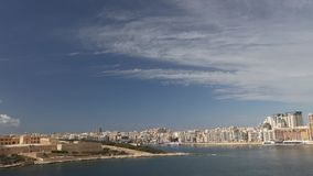 Panorama view on the Valletta city with its historic cityscape and sea and the St. Pauls Cathedral stock footage