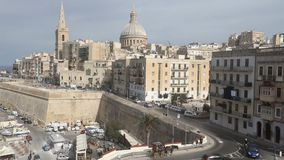 Panorama view on the Valletta city with its historic cityscape and sea and the St. Pauls Cathedral stock video