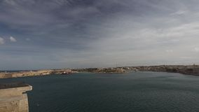 Panorama view on the Valletta city with its historic cityscape and sea and the Valletta harbor stock video footage