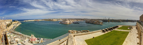 Panorama view on Valletta Grand harbor from the historic Upper Barraka garden area in Malta with historic line of cannons Stock Photos