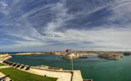 Panorama view on Valletta Grand harbor from the historic Upper Barraka garden area in Malta with historic line of cannons Royalty Free Stock Photography