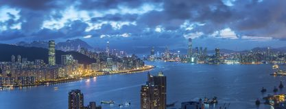 Victoria Harbor of Hong Kong city at dusk. Panorama view of Victoria Harbor of Hong Kong city at dusk Royalty Free Stock Photo