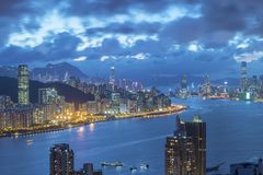 Victoria Harbor of Hong Kong city at dusk. Panorama view of Victoria Harbor of Hong Kong city at dusk Stock Photos