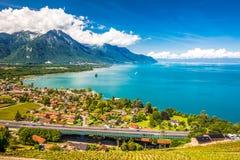 Panorama view of Villeneuve city with Swiss Alps, lake Geneva and vineyard on Lavaux region, Canton Vaud, Switzerland, Europe.  royalty free stock image