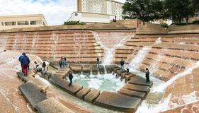 Panorama view Water Gardens in downtown Fort Worth with visitors. FORT WORTH, TX, US-DEC 24, 2018:Panorama view Water Gardens in downtown Fort Worth with stock photo