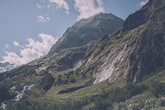 Panorama view of waterfall scene in mountains, national park of Dombay. Caucasus, Russia. Summer landscape, sunshine weather, dramatic blue sky and sunny day royalty free stock image