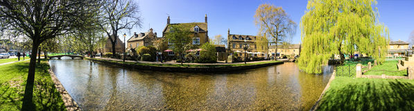 Bourton-on-the-Water, morning sunshine, river, Cotswolds, Englan Royalty Free Stock Image