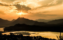 Mekong River at Sunset - Luang Prabang, Laos. Panorama view of a wonderful sunset from the hill of Mount Phou Si in Luang Prabang on Mekong River Royalty Free Stock Images