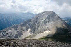 Panorama of Vihren peak in Pirin mountain, Bulgaria. In cloudy day during summer Royalty Free Stock Photography