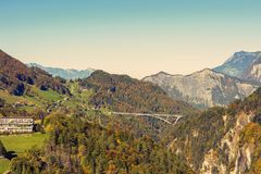 Panorama of the village and bridge against the background of the Swiss Alps at sunset. Bad Ragaz nearby. Switzerland Stock Images