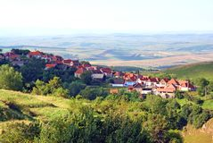Panorama with village on mountain top Royalty Free Stock Photo
