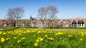Village Oudeschild on Texel island in the Netherlands. Panorama Village Oudeschild with Zeemans church and trraditional gable houses on the Wadden island Texel royalty free stock photography