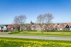 Village Oudeschild on Texel island in the Netherlands. Panorama Village Oudeschild with Zeemans church and trraditional gable houses on the Wadden island Texel royalty free stock photo