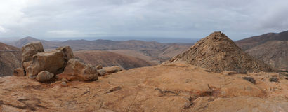 Panorama of volcanic hills, Fuerteventura. Canary Islands. Ocean in background Stock Image