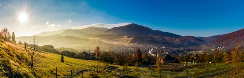 Panorama of Volovets town in Carpathian mountains. Gorgeous foggy sunrise with Magnificent Borzhava mountain ridge in a distance. beautiful countryside Royalty Free Stock Images