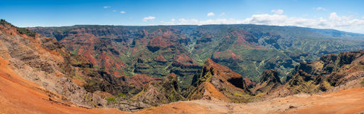Panorama of Waimea Canyon on Kauai. Early light illuminates the steep rock sides of panoramic view of Waimea Canyon on Kauai Royalty Free Stock Photo