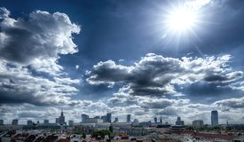 Panorama of Warsaw with clouds and sun royalty free stock images