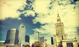Panorama of Warsaw with modern skyscrapers on a sunny day overlooking the Palace of Culture.  Old retro style photo. Royalty Free Stock Photos