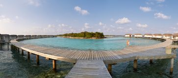 Panorama of water bungalows in hotel on Maldives. Villas on Indian ocean at luxury spa resort. Water bungalows in hotel on Maldives. Villas on Indian ocean at Stock Photo