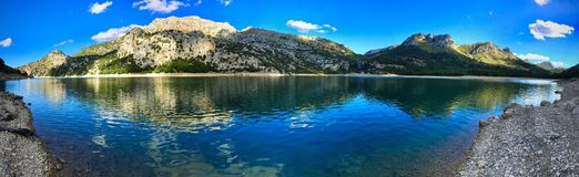 Panorama of a water reservoir at Gorg Blau, Mallorca, Spain. Panorama of a water reservoir at Gorg Blau with rocks outdoors in a mountain valley Stock Image