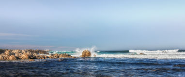 Panorama of Waves Hitting Rocks in Pacific Grove Stock Photography