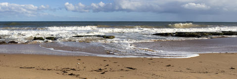 Panorama of waves splashing on basalt rocks at Ocean beach Bunbury  Western Australia Stock Photo