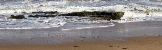 Panorama of waves splashing on basalt rocks at Ocean beach Bunbury  Western Australia Stock Photos