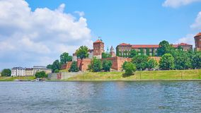Panorama of Wawel Castle and Vistula river, Krakow, Poland. Panorama of Wawel Castle, its medieval towers and massive rampart are surrounded by lush greenery of stock video